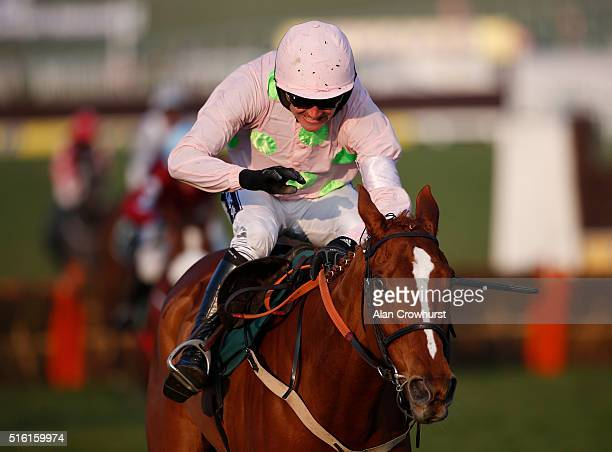 Ruby Walsh riding Limini clear the last to win The Trull House Stud Mares' Novices' Hurdle Race during Cheltenham Festival St Patrick's Thursday at...