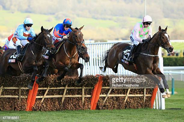 Ruby Walsh riding Vautour leads the pack over a fence in The Sky Bet Supreme Novices' Hurdle during The Festival Champion Day at Cheltenham...