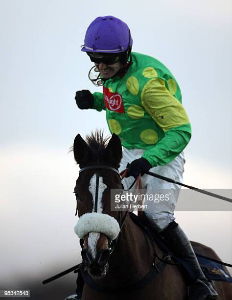 Ruby Walsh shows his delight after Kauto Star won The William Hill King George VI Steeple Chase Race run at Kempton Park on December 26, 2009 in...