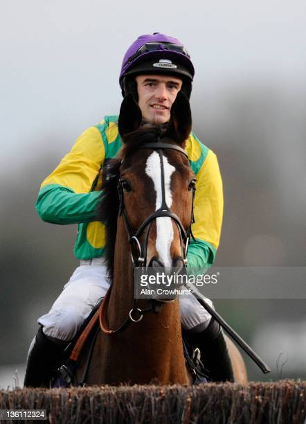 Ruby Walsh smiles as he and Kauto Star win The William Hill King George VI Steeple Chase at Kempton racecourse on December 26, 2011 in Sunbury,...