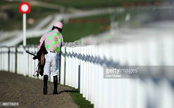 Ruby Walsh walks back to the weighing room after falling from Annie Power whilst leading at the last in The OLBG Mares' Hurdle Race during Day One of...