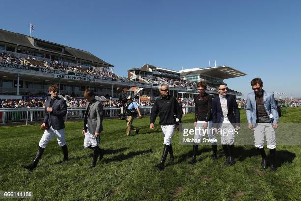 Ruby Walsh walks down the course with fellow jockeys during day three of the Randox Health Grand National meeting at Aintree Racecourse on April 8...