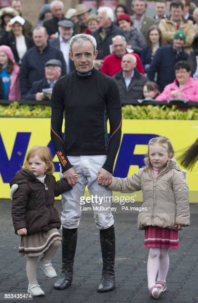 Ruby Walsh with his two daughters during day five of the Punchestown Festival at Punchestown Racecourse Co Kildare Ireland