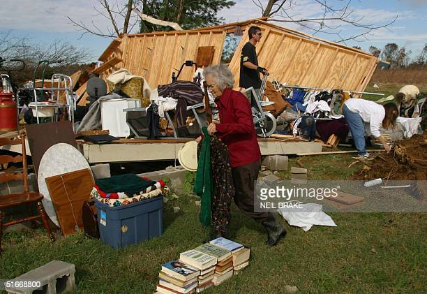 Ruby Waterson carries clothes as she helps gather items from a storage shed in Coffee County, near Manchester, TN, 11 November 2002 caused by a...