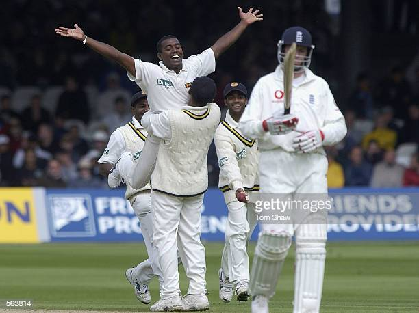 Ruchura Perera of Sri Lanka celebrates trapping Graham Thorpe of England leg before wicket during the third day of the first Test Match between...