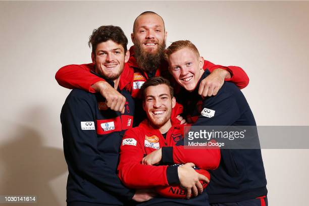 Ruckman Max Gawn hugs midfielders Angus Brayshaw Jack Viney and Clayton Oliver of the Demons pose during a Melbourne Demons AFL media opportunity at...