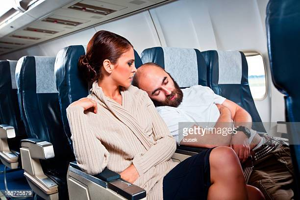 rude passenger on the airplane - irritation stock pictures, royalty-free photos & images