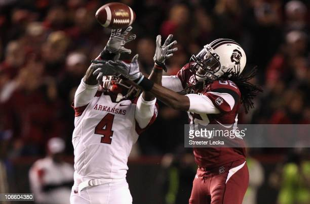 Rudell Crim of the Arkansas Razorbacks breaks up a pass to D.L. Moore of the South Carolina Gamecocks during their game at Williams-Brice Stadium on...