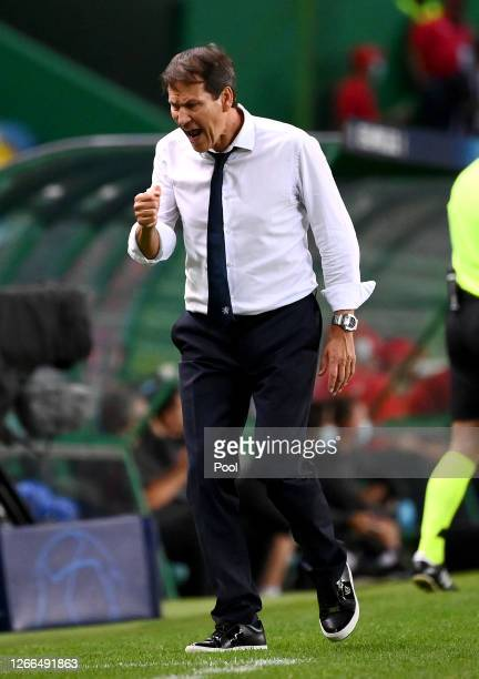 Rudi Garcia Head Coach of Olympique Lyon celebrates after his team score during the UEFA Champions League Quarter Final match between Manchester City...