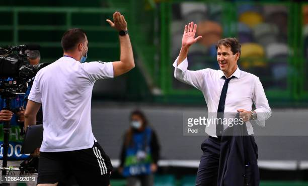 Rudi Garcia, Head Coach of Olympique Lyon celebrates following his team's victory in the UEFA Champions League Quarter Final match between Manchester...