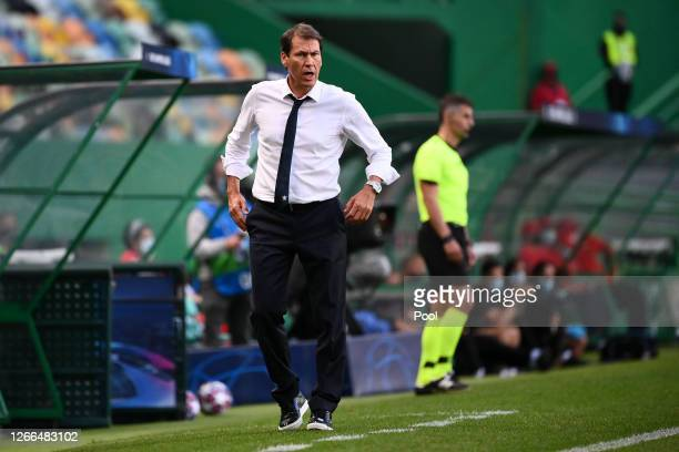 Rudi Garcia Head Coach of Olympique Lyon gives his team instructions during the UEFA Champions League Quarter Final match between Manchester City and...