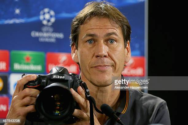 Rudi Garcia, head coach of Roma takes pictures during a AS Roma press conference prior to their UEFA Champions League match against FC Bayern...
