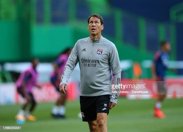 Rudi Garcia the head coach of Olympique Lyonnais looks on during a training session ahead of their UEFA Champions League Quarter Final match against...