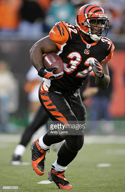 Rudi Johnson of the Cincinnati Bengals runs with the ball during the AFC Wild Card Playoff Game against the Pittsburgh Steelers at Paul Brown Stadium...