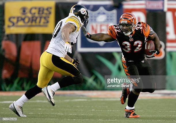 Rudi Johnson of the Cincinnati Bengals stiff arms Larry Foote of the Pittsburgh Steelers during the first quarter of the AFC Wild Card Playoff Game...