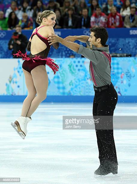 Rudi Swiegers and Paige Lawrence of Canada compete during the Figure Skating Pairs Short Program on day 4 of the Sochi 2014 Winter Olympics at...