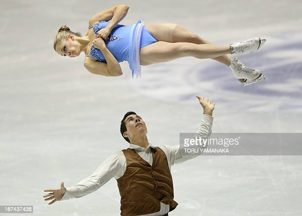 Rudi Swiegers of Canada tosses his partner Paige Lawrence during the pairs' free skating event in the NHK Trophy the fourth leg of the sixstage ISU...