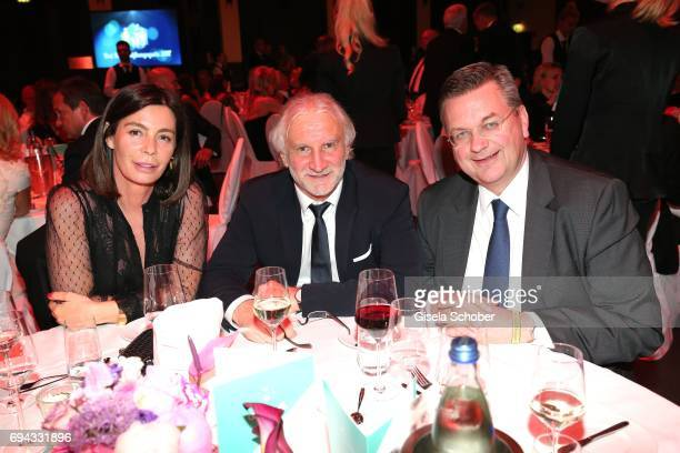 Rudi Voeller and his wife Sabrina Voeller DFB President Reinhard Grindel during the Toni Kroos charity gala benefit to the Toni Kroos Foundation at...