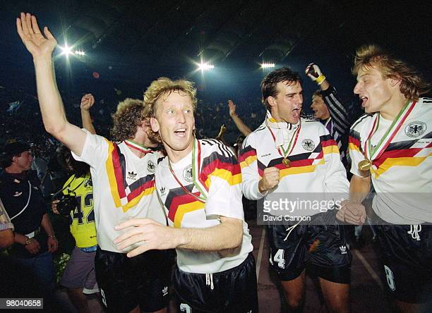 Rudi Voeller Andreas Brehme Juergen Kohler Bodo Illgner and Juergen Klinsmann of Germany celebrate their defeat of Argentina in the 1990 FIFA World...
