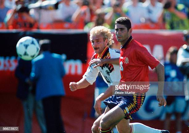 Rudi Voeller of Germany and Fernando Hierro of Spain in action during the World Cup match between Germany and Spain on June 21 1994 in Chcago United...