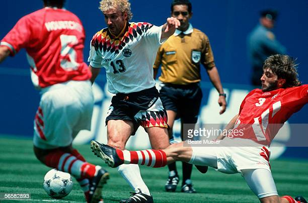 Rudi Voeller of Germany and Trifon Ivanov of Bulgaria in action during the World Cup quarter final match between Bulgaria and Germany on July 10 1994...