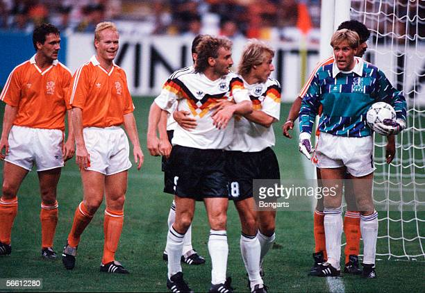 Rudi Voeller of Germany clash with Netherlands goalkeeper Hans van Breukelen during the World Cup eighth final match between Germany and Netherlands...