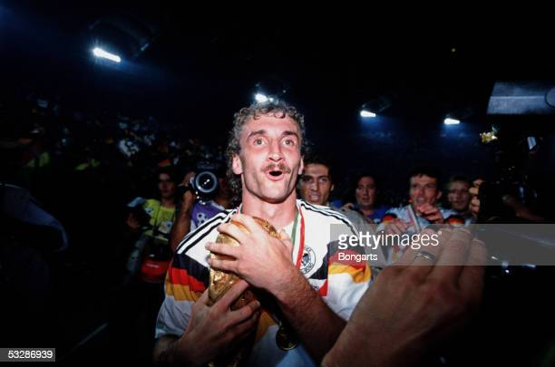 Rudi Voeller of Germany holds the trophy after the German team won the FIFA World Championship final match between Argentina and Germany on July 8,...