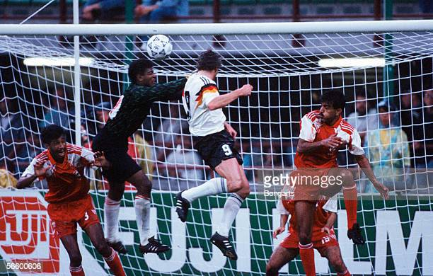 Rudi Voeller of Germany scores the fifth goal for Germany during the World Cup group D match between Germany and United Arab Emirates at the Guiseppe...
