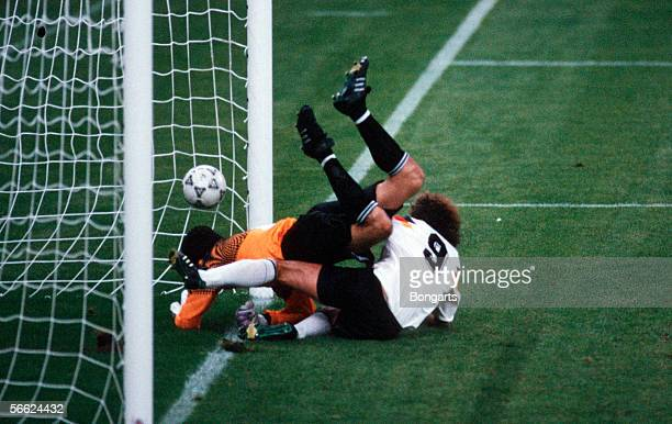 Rudi Voeller of Germany scores the fourth goal for Germany during the World Cup match between Germany and Yugoslavia on June 10 1990 in Milan Italy
