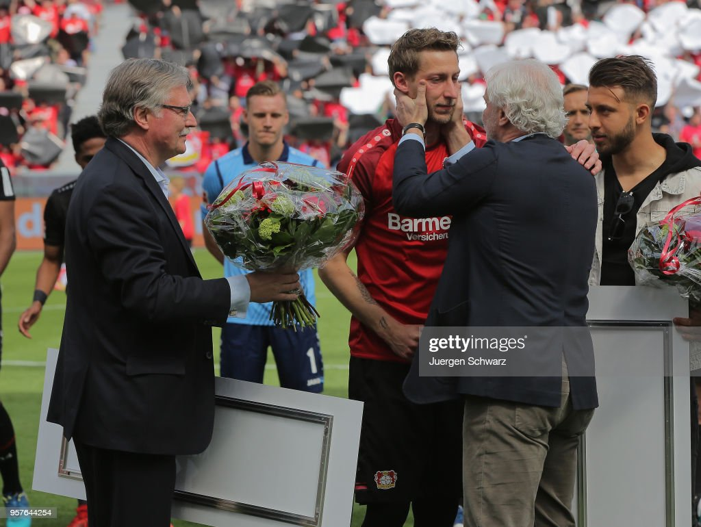 Rudi Voeller of Leverkusen (R) hugs Stefan Kiessling who is going to say farewell after the Bundesliga match between Bayer 04 Leverkusen and Hannover 96 at BayArena on May 12, 2018 in Leverkusen, Germany.