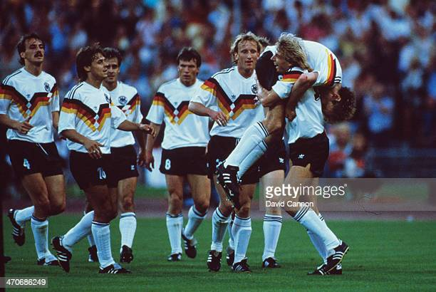 Rudi Voller of West Germany celebrates with teammates after scoring his first goal of the match during the UEFA European Championships 1988 Group 1...