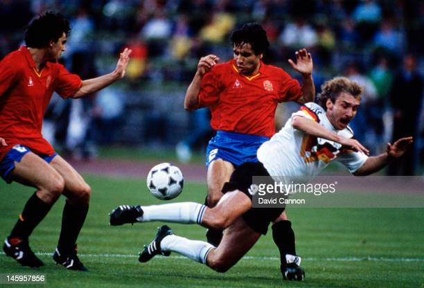 Rudi Voller of West Germany is tackled by Manuel Sanchis and Tomas Renones of Spain during the UEFA European Championships 1988 Group 1 match between...