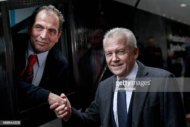Rudiger Grube CEO of Deutsche Bahn shakes hand with a engine driver during the launch of the ICE 4 highspeed train fleet on December 4 2015 in Berlin...