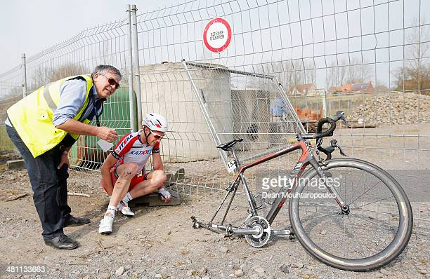 Rudiger Selig of Germany is attended to by race staff after he crashes and is injured in the E3 Harelbeke Cycle Race on March 28, 2014 in Harelbeke,...