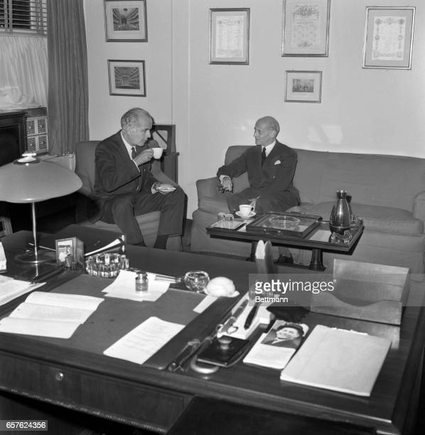 """Rudolf Bing uses his regular 4 p.m. """"tea break"""" to confer with American composer, Samuel Barber in the general manager's small office. Barber's new..."""