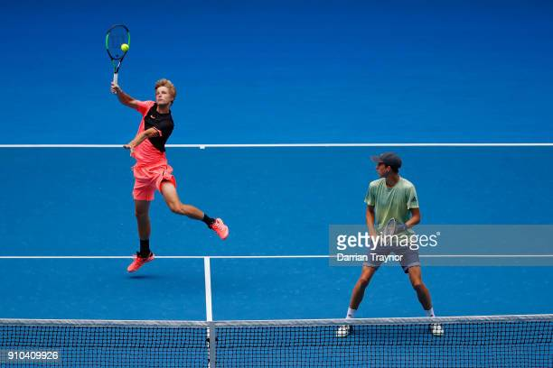 Rudolf Molleker of Germany and Henri Squire of Germany compete in the boy's doubles final against Hugo Gaston of France and Clement Tabur of France...