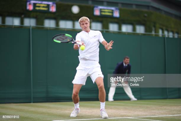 Rudolf Molleker of Germany in action against George Loffhagen of Great Britain in the Boys' Singles Tournament during the Wimbledon Lawn Tennis...