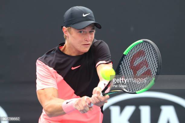 Rudolf Molleker of Germany plays a backhand against Tomas Machac of the Czech Republic during the Australian Open 2018 Junior Championships at...