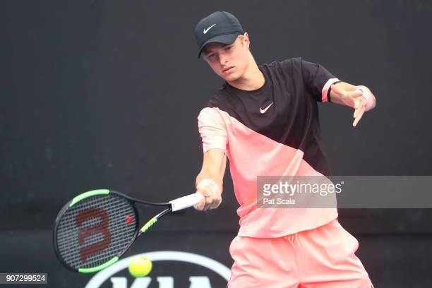 Rudolf Molleker of Germany plays a forehand against Tomas Machac of the Czech Republic during the Australian Open 2018 Junior Championships at...