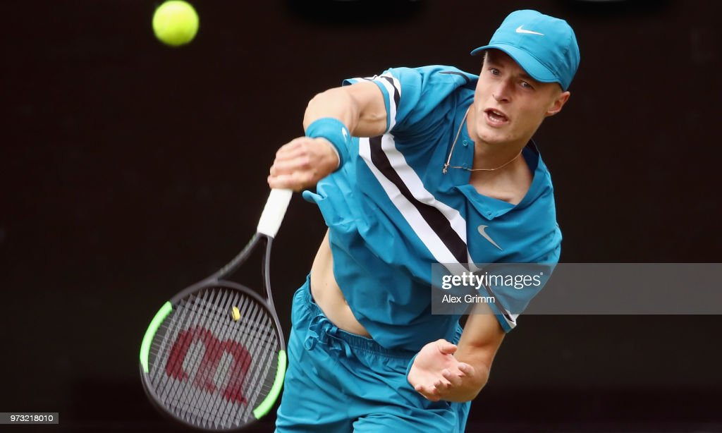 Rudolf Molleker of Germany serves the ball to Lucas Pouille of France during day 3 of the Mercedes Cup at Tennisclub Weissenhof on June 13, 2018 in Stuttgart, Germany.