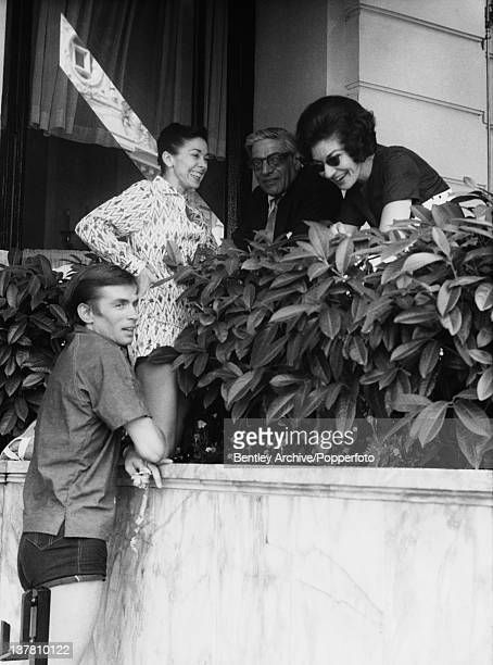 Rudolf Nureyev and Margot Fonteyn climbing the outside of the Hotel de Paris in Monaco to meet Aristotle Onassis and Maria Callas 1st August 1963...