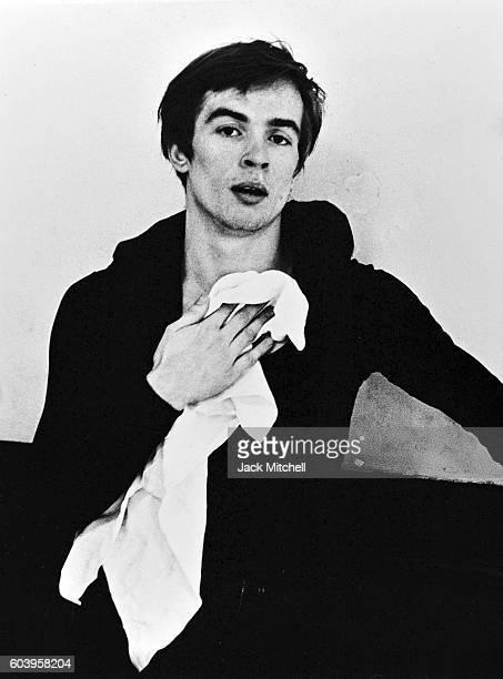 Rudolf Nureyev cooling down after dance class 1962