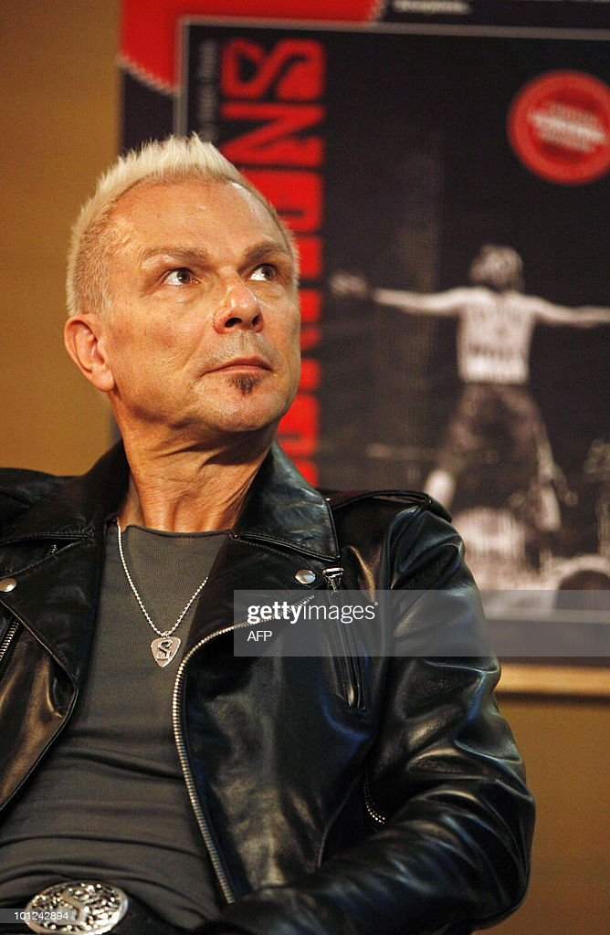 Rudolf Schenker of the German rock band Scorpions addresses a press conference on May 28, 2010 at the Dussmann bookshop in Berlin during the presentation of a new coffee-table book by photographer Marc Theis. The photographer accompanied the band on their world tour from 2007 to 2009.