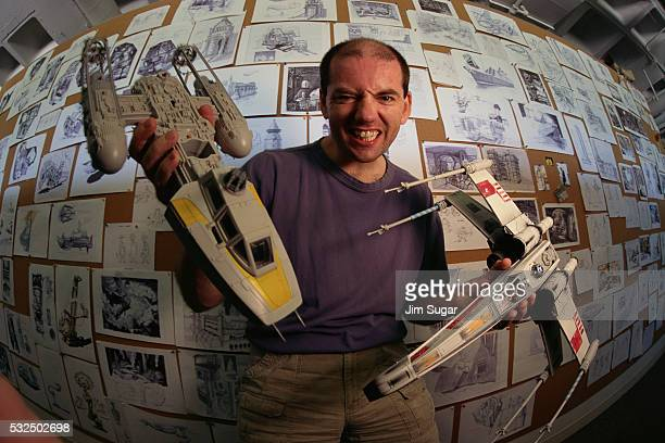 rudolf stember holding star wars models - star wars stock pictures, royalty-free photos & images