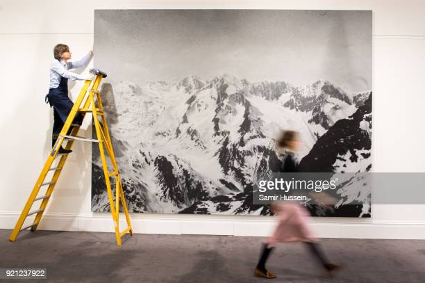 Rudolf Stingel's monumental painting of the Tyrolean Alps in Italy based on a historic photograph is prepared for exhibition at Sotheby's in London...