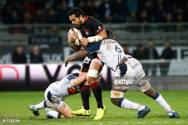 Rudolffe Rudy Wulf of Lyon Yoan Tanga Mangene of Agen and Jake Aron Mcintyre of Agen during the Top 14 match between Lyon and Agen at Gerland Stadium...