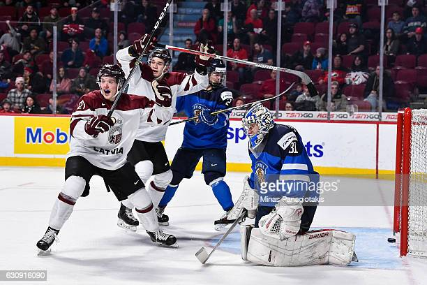 Rudolfs Balcers and teammate Erlends Klavins of Team Latvia react after a goal on goaltender Veini Vehvilainen of Team Finland during the 2017 IIHF...