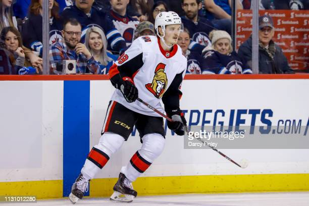 Rudolfs Balcers of the Ottawa Senators keeps an eye on the play during second period action against the Winnipeg Jets at the Bell MTS Place on...