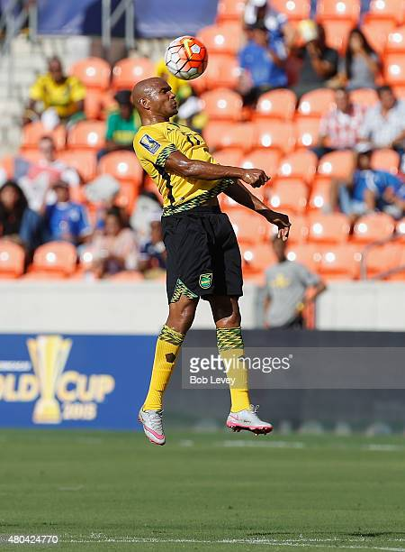 Rudolph Austin of Jamaica head the ball out of the offensive zone against Canada inj the first half at BBVA Compass Stadium on July 11 2015 in...