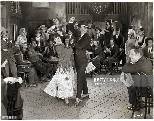Rudolph Valentino dancing with a senorita in a Spanish cafe Movie still